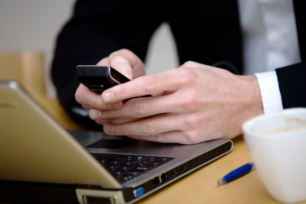 A consultant using his mobile phone, Stockholm, Sweden --- Image by © Juliana Wiklund/Johnér Images/Corbis