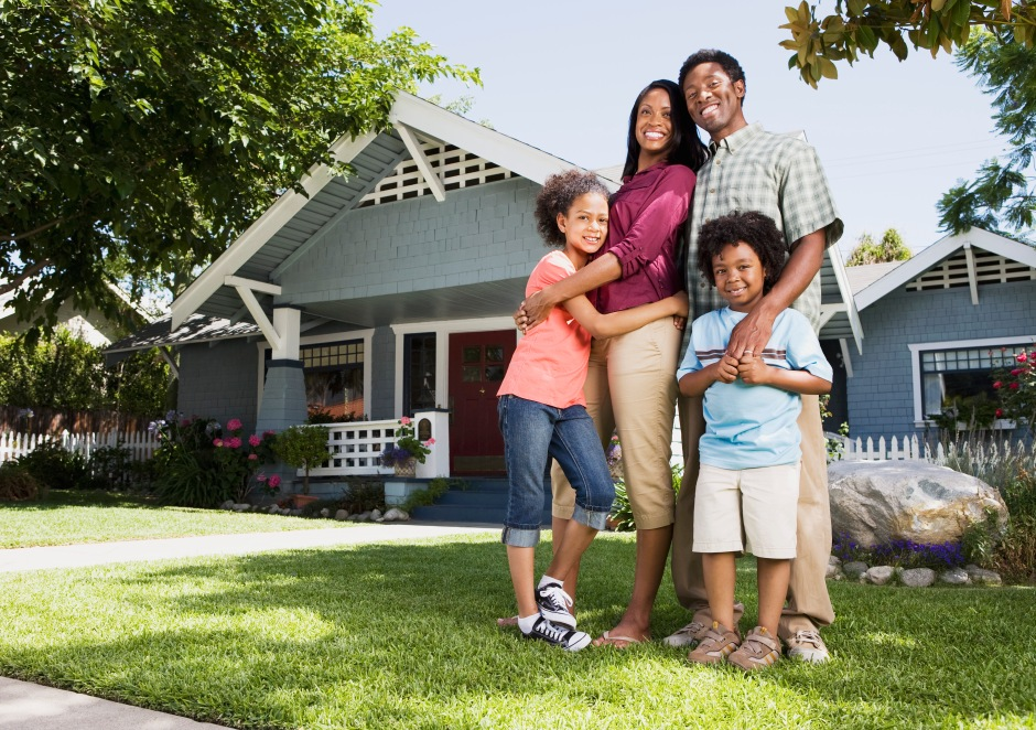 Embracing family in front of home